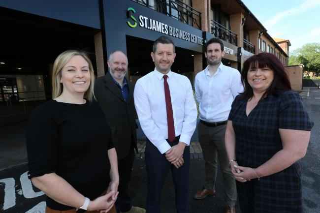 Staff outside the refurbished St James Business Centre