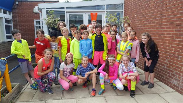 Warrington Guardian: Pupils at St Monica's Catholic Primary School wearing their brightest neon