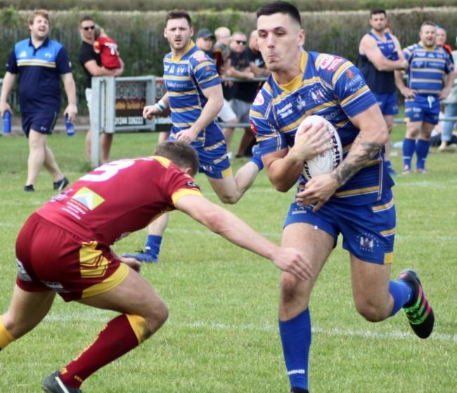Luke Walker makes progress for Crosfields during Saturday's win over Wigan St Judes
