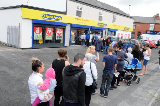 Dozens of shoppers queued as Heron Foods opened its doors on Orford Lane.