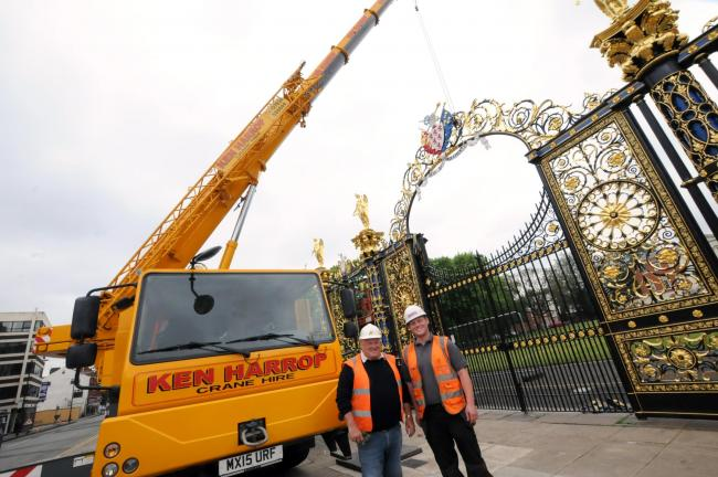 Ken Harrop and son Jack Harrop of Ken Harrop Crane Hire with the Golden Gates as they are lifted out of place.