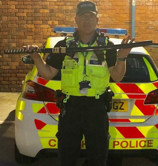 Police with the samurai, seized from a car on Watkin Street in Orford.
