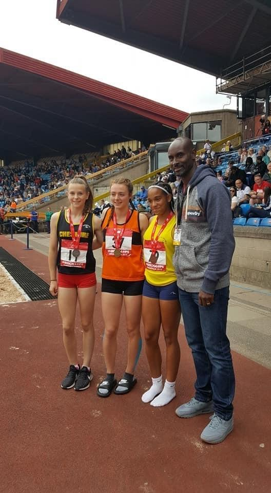 Meg Corker, far left, with her junior girls 75m hurdles silver medal