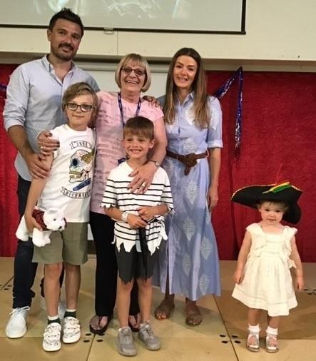 Anne Carr and her family during a special celebration assembly