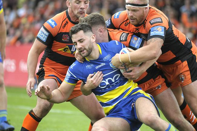 Toby King is surrounded by Castleford defenders. Picture by Mike Boden