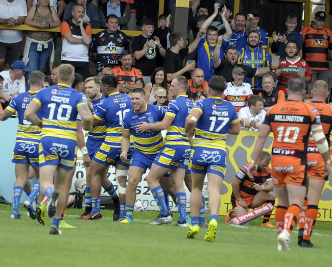 Tom Lineham is congratulated after scoring at Castleford. Picture by Mike Boden