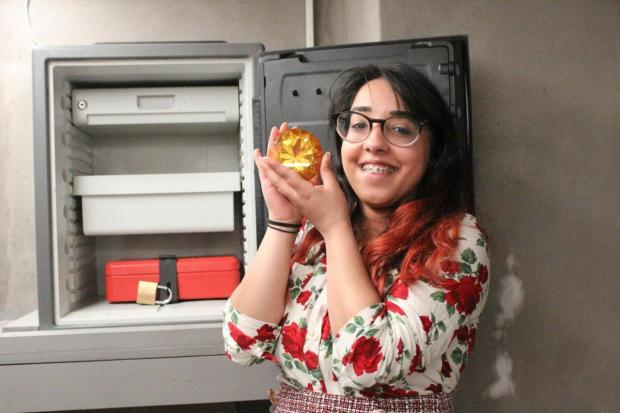 Warrington Guardian: Lancashire Telegraph reporter Alima Nadeem with her hands on the prize jewel from one of the breakout rooms at Lucardo in Rawtenstall