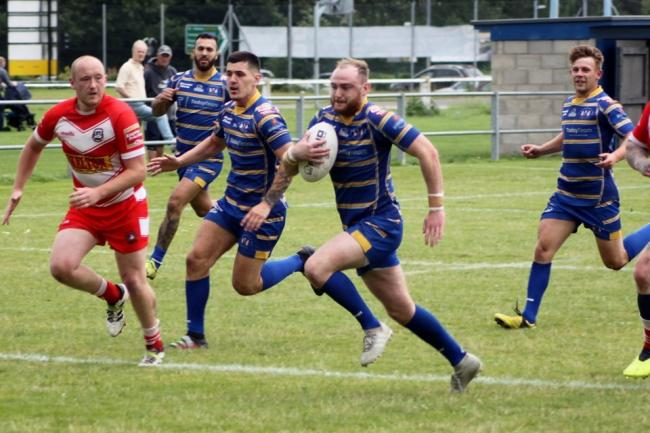 Brad Stanway breaks through the East Leeds defence