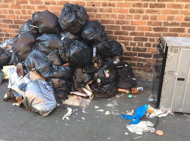 Around a dozen bin bags filled with rubbish and an oven have been dumped at the rear of Orford Lane.