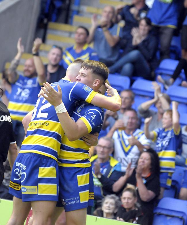 Riley Dean and Josh Thewlis celebrate the latter's try against St Helens. Picture by Mike Boden