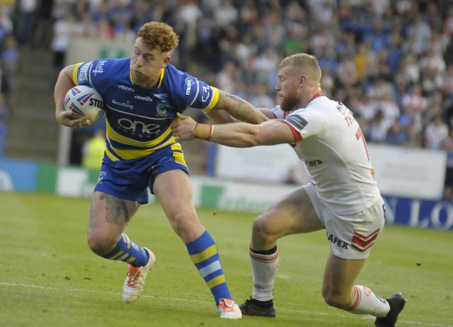 Warrington Wolves back rower Harvey Livett looks for a way past St Helens prop Luke Thompson.                Picture: Mike Boden