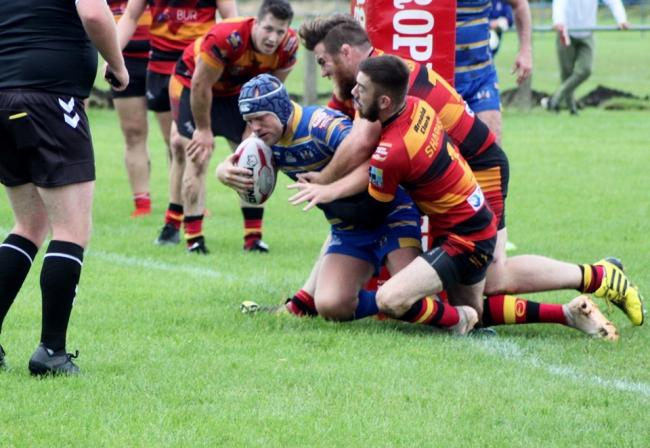 Jack Reid scores one of his three tries in Saturday's win over Shaw Cross Sharks
