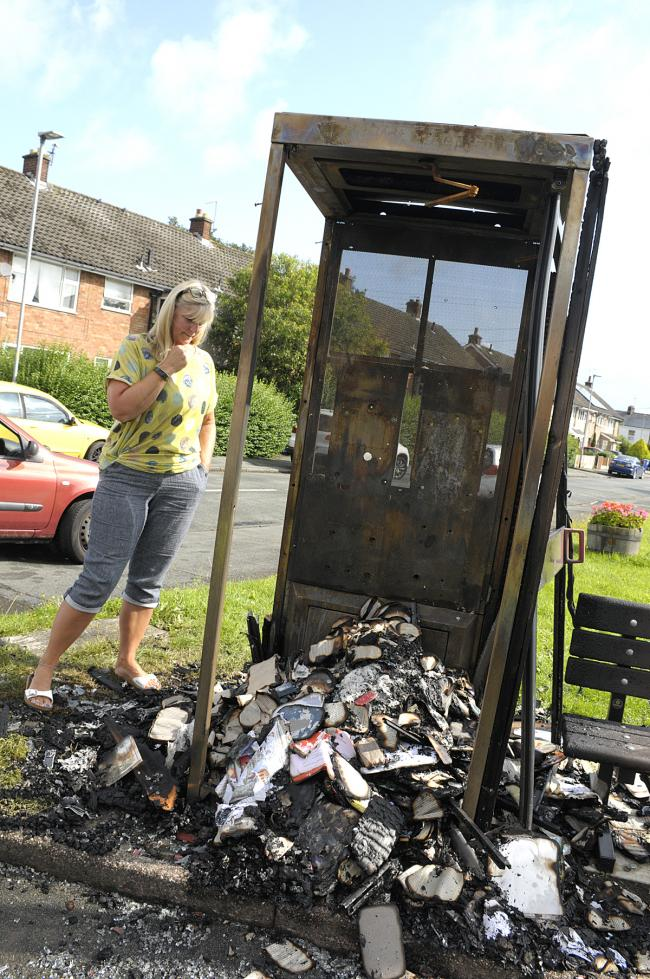 The converted phone box was gutted by the blaze, which is believed to have been started deliberately.
