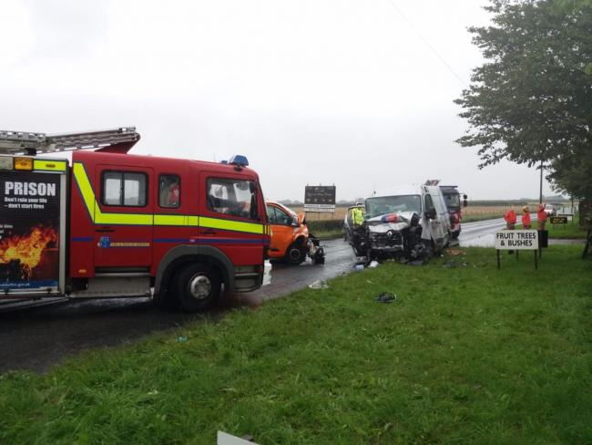 Two vans and a car were involved in the crash on Winwick Lane in Kenyon this morning.