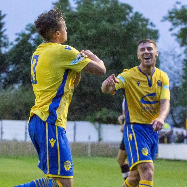 Louis Barnes celebrates scoring on his Warrington Town debut against Atherton Collieries. Picture by John Hopkins