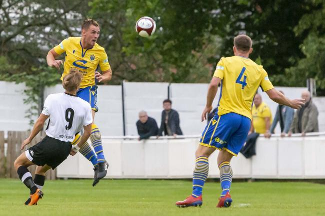 Jay McCarten heads clear against Atherton Collieries earlier this season. Picture by John Hopkins
