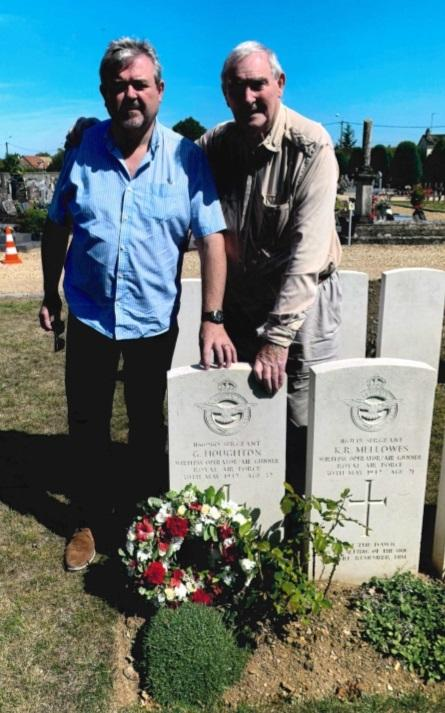 John, right, with his son Bernard at the graveside