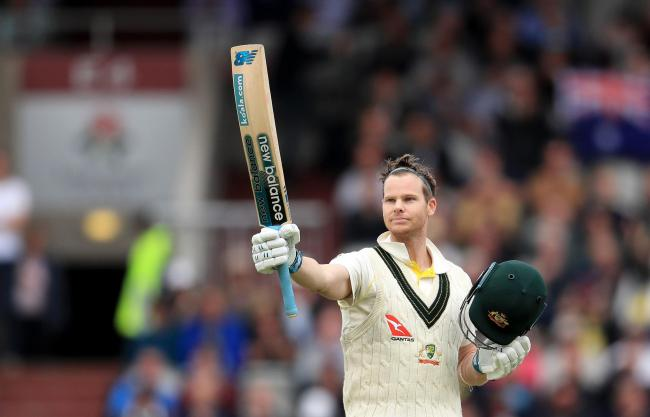 Steve Smith celebrates scoring a double-century against England in the fourth Ashes Test at Old Trafford. Picture by Mike Egerton/PA Wire
