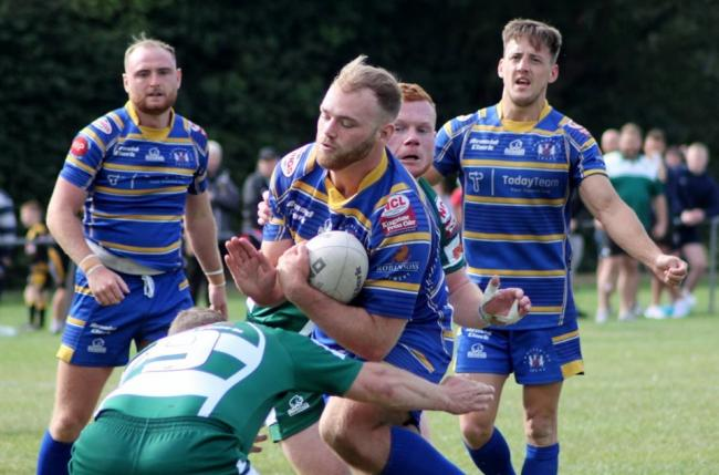 Brad Stanway is tackled during Crosfields' play-off final defeat to Hull Dockers