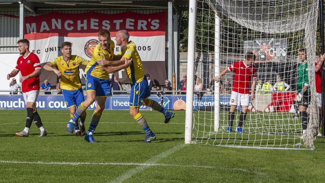 Warrington Town beat FC United of Manchester in the last round to set up their trip to Brackley Town. Picture by John Hopkins