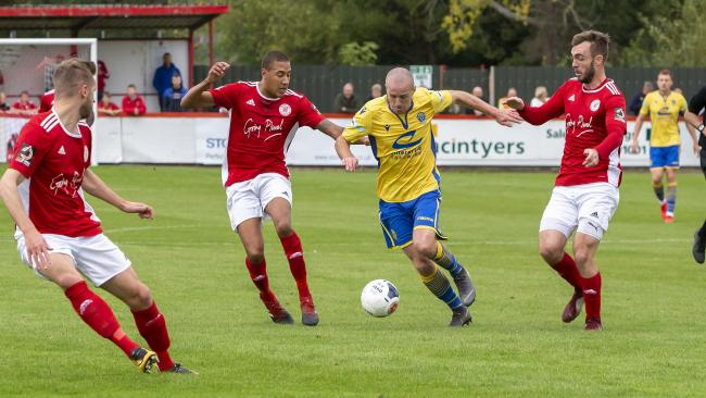 Tony Gray is surrounded by Brackley defenders. Picture by John Hopkins