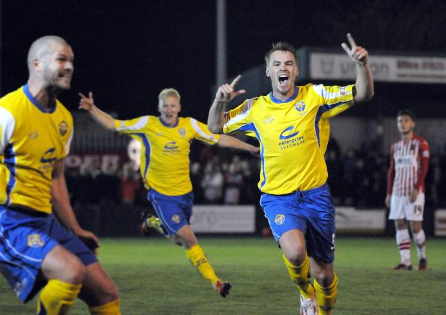 Jay McCarten celebrates Craig Robinson's famous winning goal against Exeter City in the 2014 FA Cup. Picture by Mike Boden
