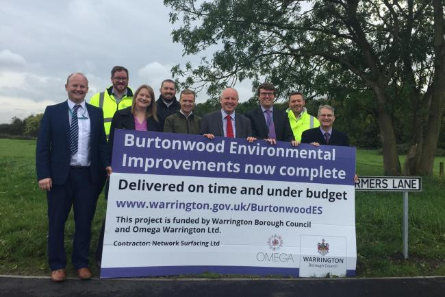 Council members and officers celebrate the completion of the Burtonwood Environmental Improvements Scheme