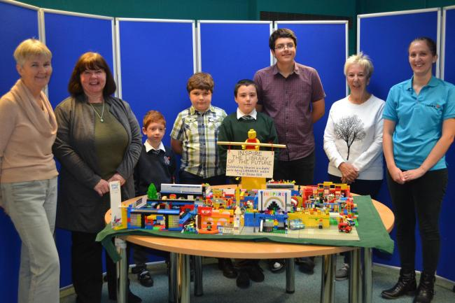 Memebers of Padgate Library's Lego Club with representatives from the Friends of Padgate Library and Livewire
