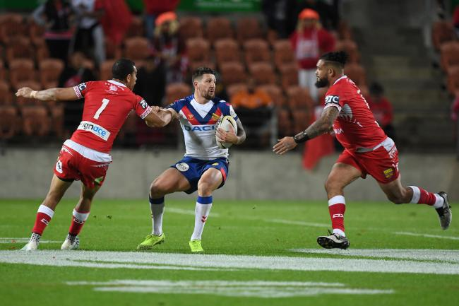 Ben Murdoch-Masila, right, comes in to tackle future Wire teammate Gareth Widdop. Picture by Jeremy Ward/photosport.nz
