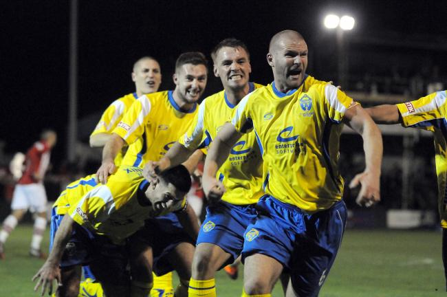 Craig Robinson celebrates his winning goal against Exeter City. Picture by Mike Boden