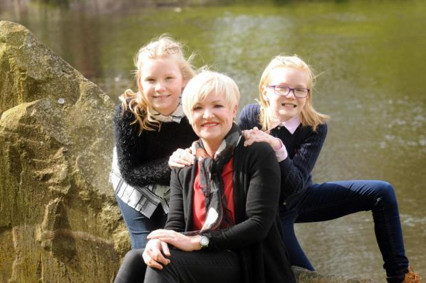 Warrington Guardian: Mel O'Neill with her two daughters