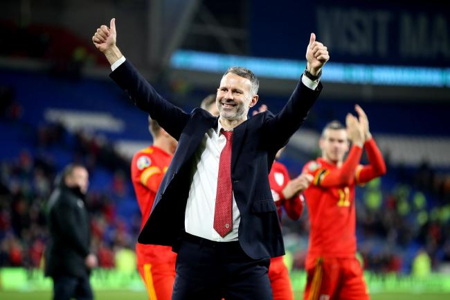 Wales manager Ryan Giggs celebrates victory and qualification