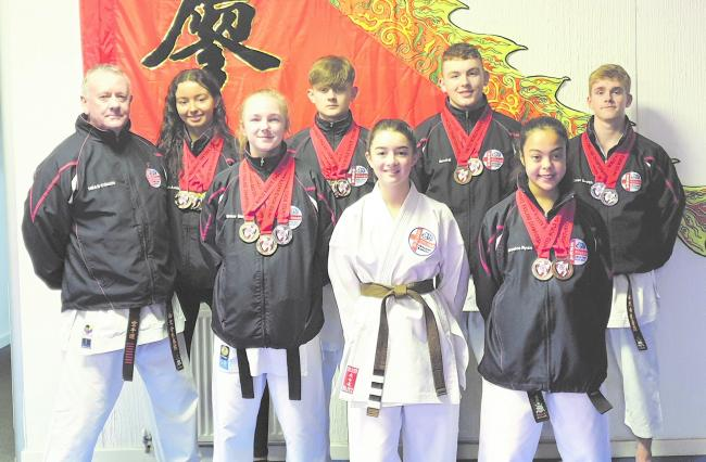 Cheshire Martial Arts Centre medallists alongside chief instructor Paul Graham