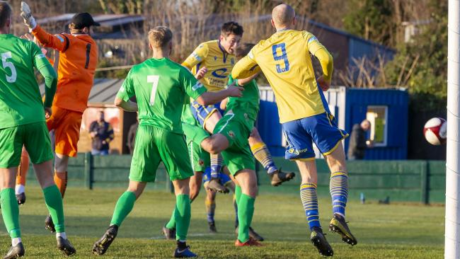 Ben Garrity heads in Town's second against Nantwich. Picture by John Hopkins