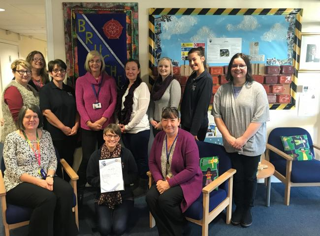 Bruche Primary School lead teaching assistant Alicia Dignan-Smith and the school's TA team are pictured with the award