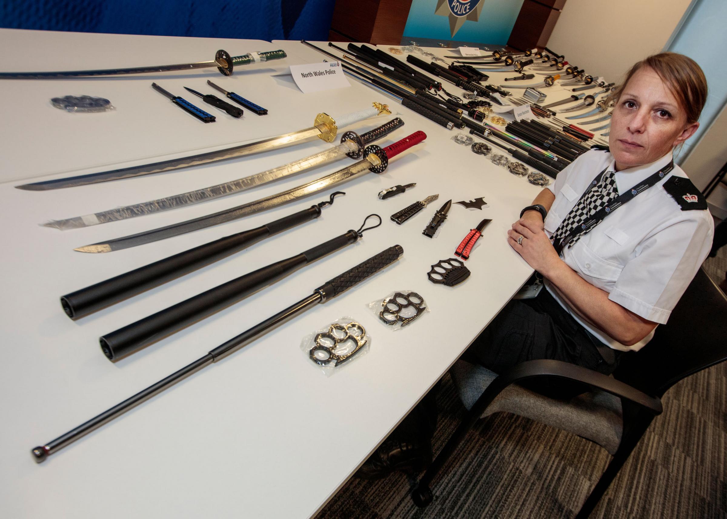 Police intercept swords and Batman throwing knife in post