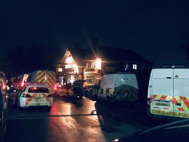Police at The Blackburne Arms in Orford Green last night, Friday