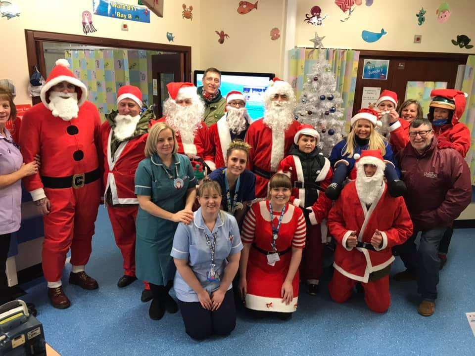 Santas hit their scooters to help out at children's ward
