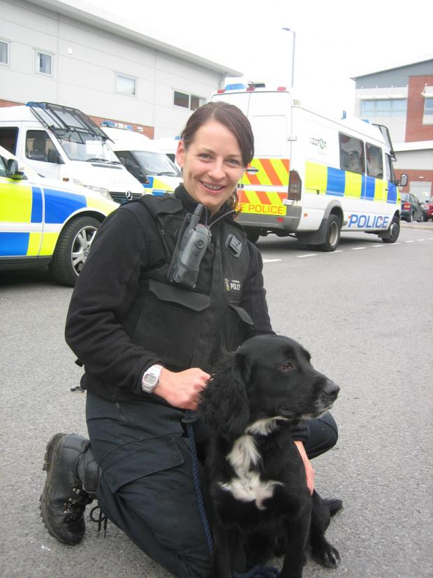 Dog handler Keeley Powles with Ollie