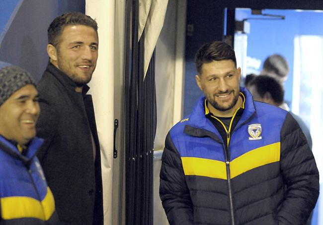 Gareth Widdop watches last night's friendly against Salford alongside former England teammate Sam Burgess, who was a guest at the match. Picture by Mike Boden