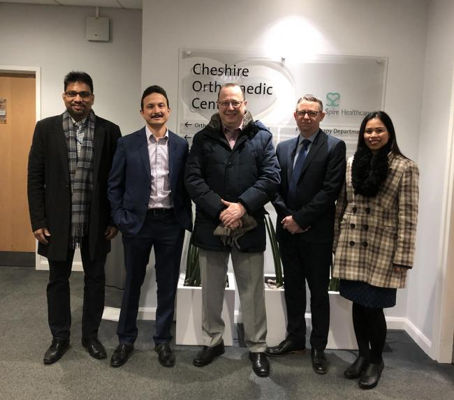 Mr Pradhan is pictured with visiting surgeons from the University Hospital Coventry and Warwick and sales representatives from knee implant manufacturer Zimmer.