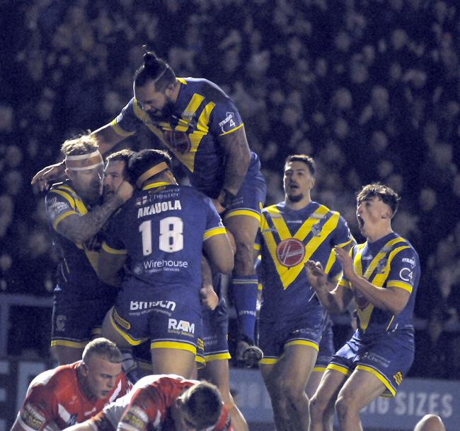 The Wire celebrate Daryl Clark's try against St Helens. Picture by Mike Boden