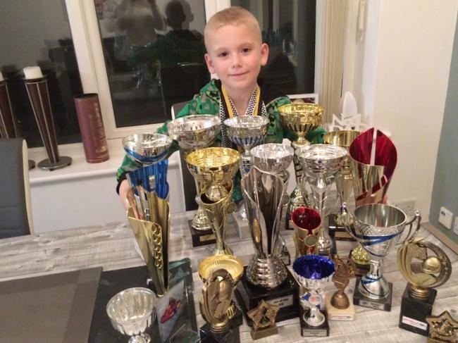 Luca Narraway with some of his go-karting silverware