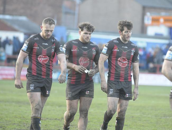 Ben Currie, Joe Philbin and Stefan Ratchford trudge from the field after the defeat to Wakefield. Picture by Mike Boden