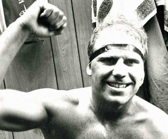 Warrington Wolves captain Mike Gregory celebrates in the changing rooms after steering The Wire to Wembley in 1990