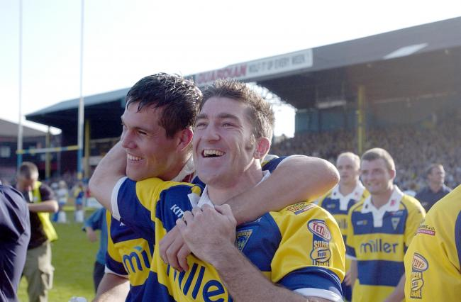 Nathan Wood and Brent Grose celebrate Wire's exit from Wilderspool Stadium after hammering Wakefield in the final league game on the ground in 2003. Picture: Mike Boden