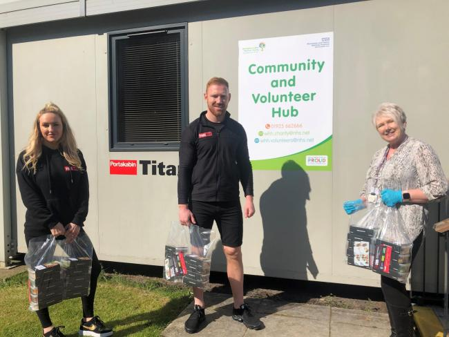 James Laithwaite and Michelle McDowall Fuel Hub Home Chef Direct - with Warrington and Halton Hospitals' Charity manager Helen Higginson