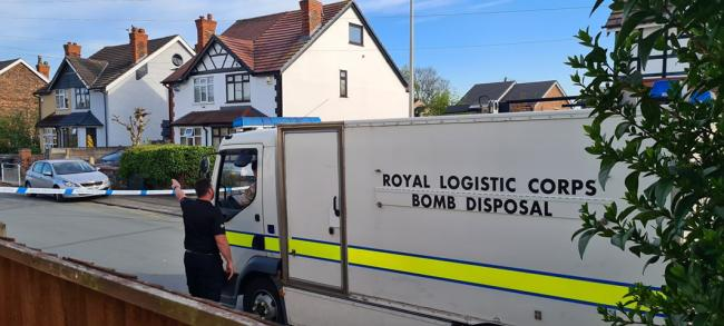 Police on Birtles Road in Orford after an explosive device was planted outside a house