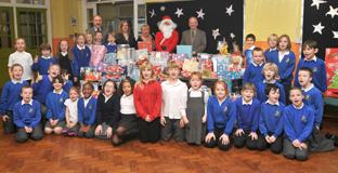 St George's Primary School pupils with the gifts they have collected