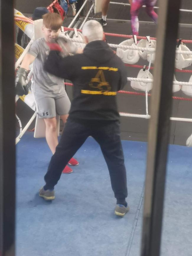 Alfie enjoying his 121 at hook and jab  boxing club with his coach